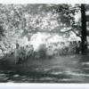 francis_robert_19570822_speaking_at_reading_in_jones_library_garden.jpg