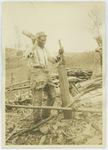 Black man splitting wood in Virginia