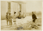 Splitting wood for the schoolhouse fire