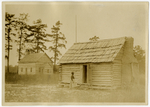 A Negro schoolhouse and Baptist church